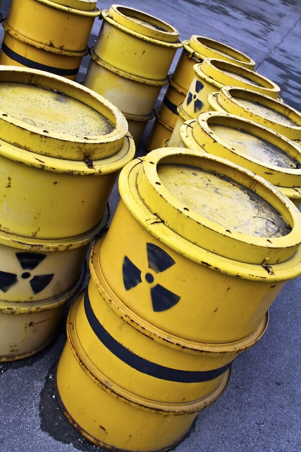 Radioactive-Warning-Symbol-On-Yellow-Tuns-Of-Toxic-Waste