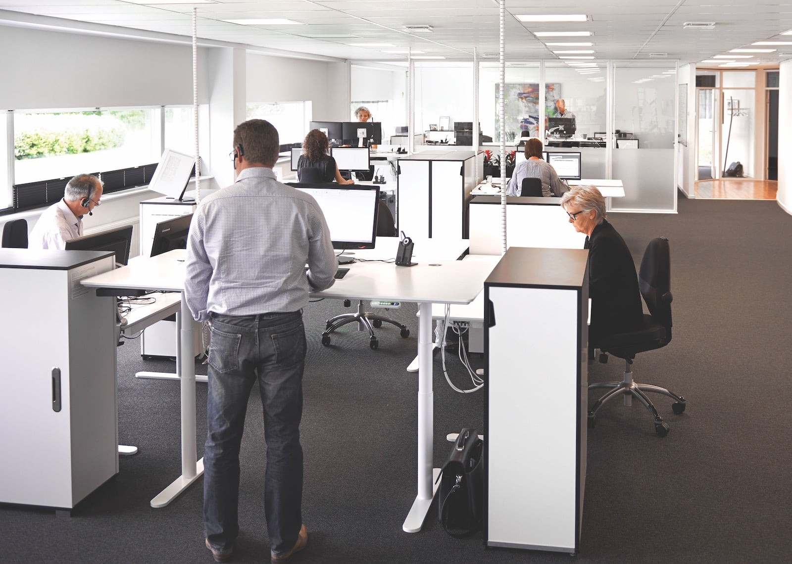 people with their respective tables with ergonomic products